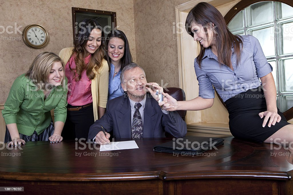 Senior man with team of young women royalty-free stock photo