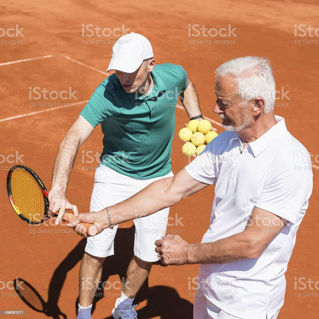 Senior man with tennis instructor royalty-free stock photo