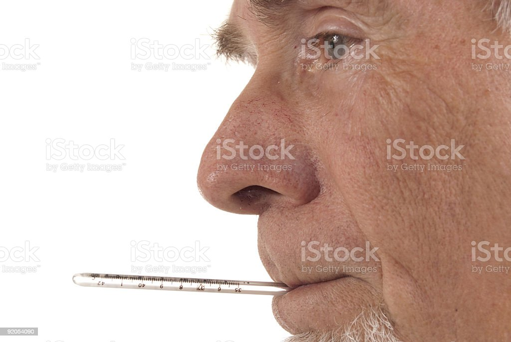 Senior man with thermometer in mouth stock photo