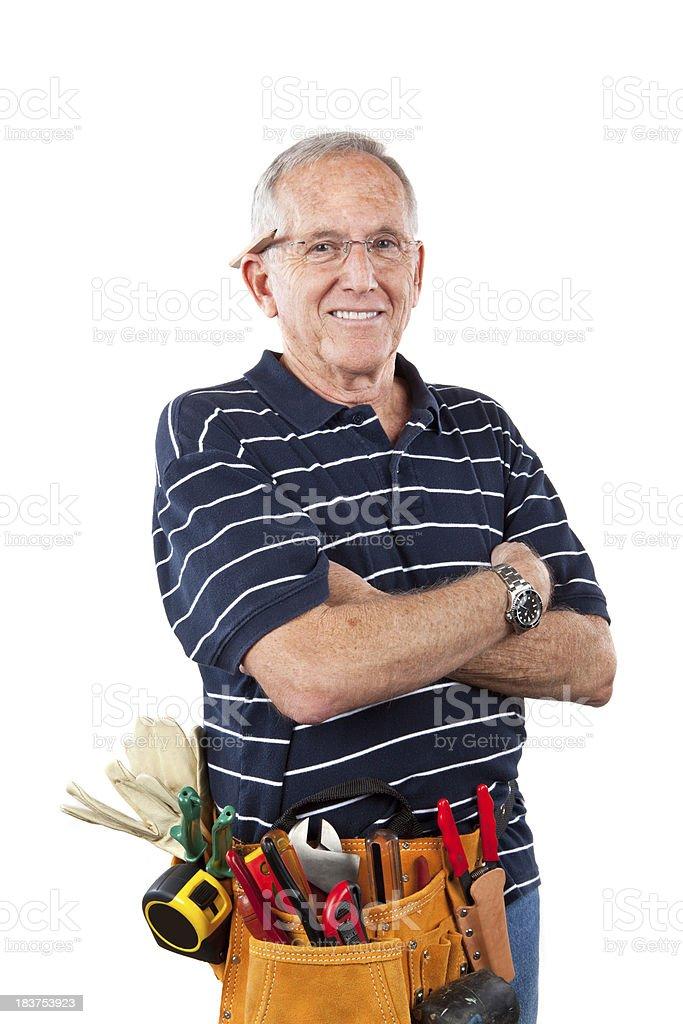 senior man with tool belt stock photo