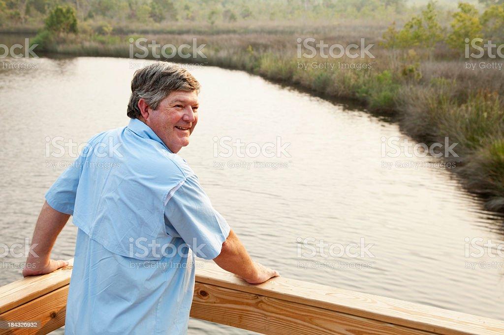 Senior man with view of lake stock photo