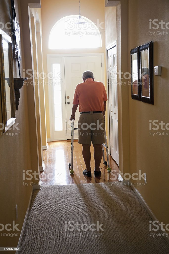 Senior man with walker at home stock photo