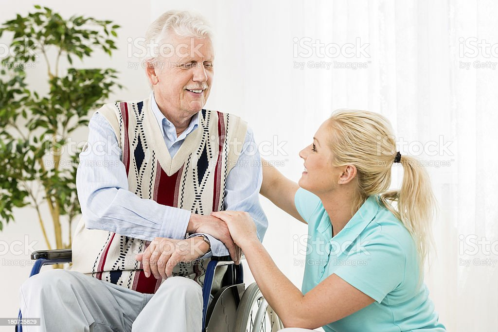 Senior Man with Wheelchair and Caregiver royalty-free stock photo