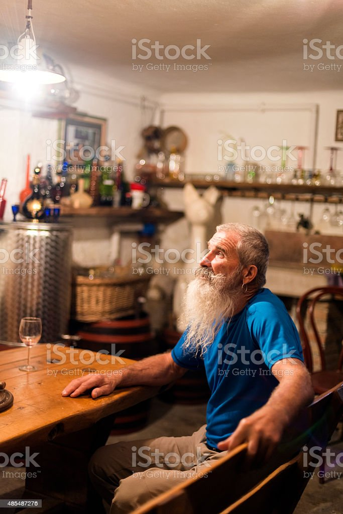 Senior Man with White Beard in Old Cellar, Europe stock photo