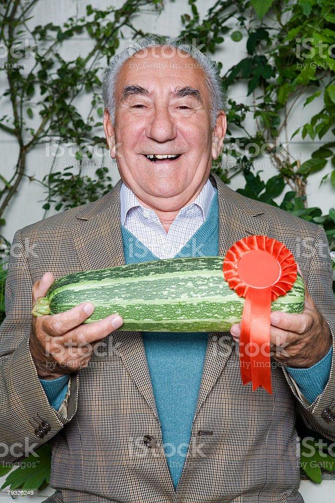 Senior man with winning marrow stock photo