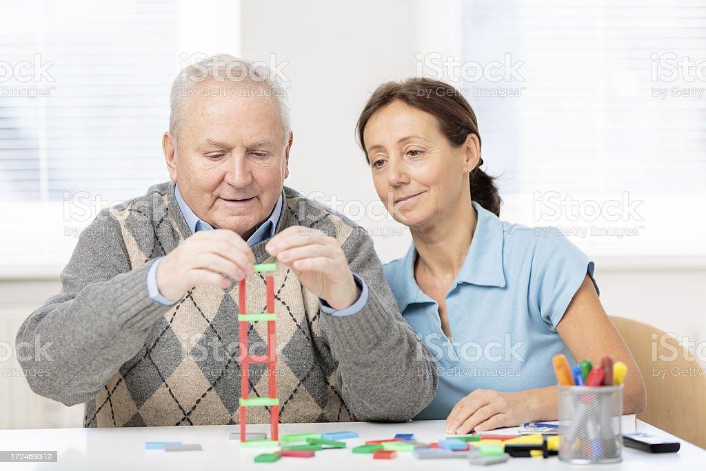 Senior man with wooden block stock photo