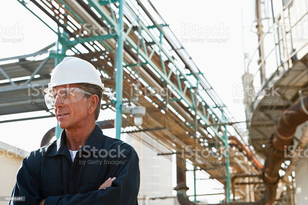 Senior man working as an engineer at an industrial plant royalty-free stock photo