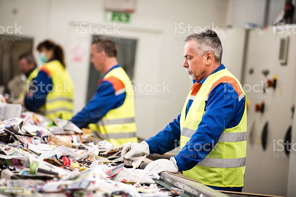 Senior man working at paper recycling plant stock photo