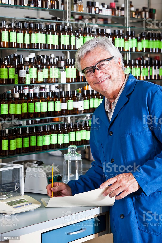 Senior man working in chemical plant royalty-free stock photo