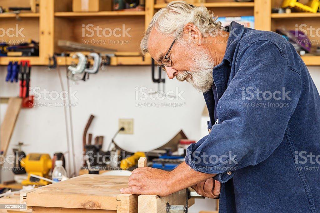 Senior Man Working in His Workshop stock photo