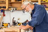 Senior Man Working in His Workshop