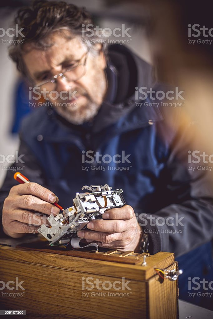Senior Man Working in Mechanical Workshop stock photo
