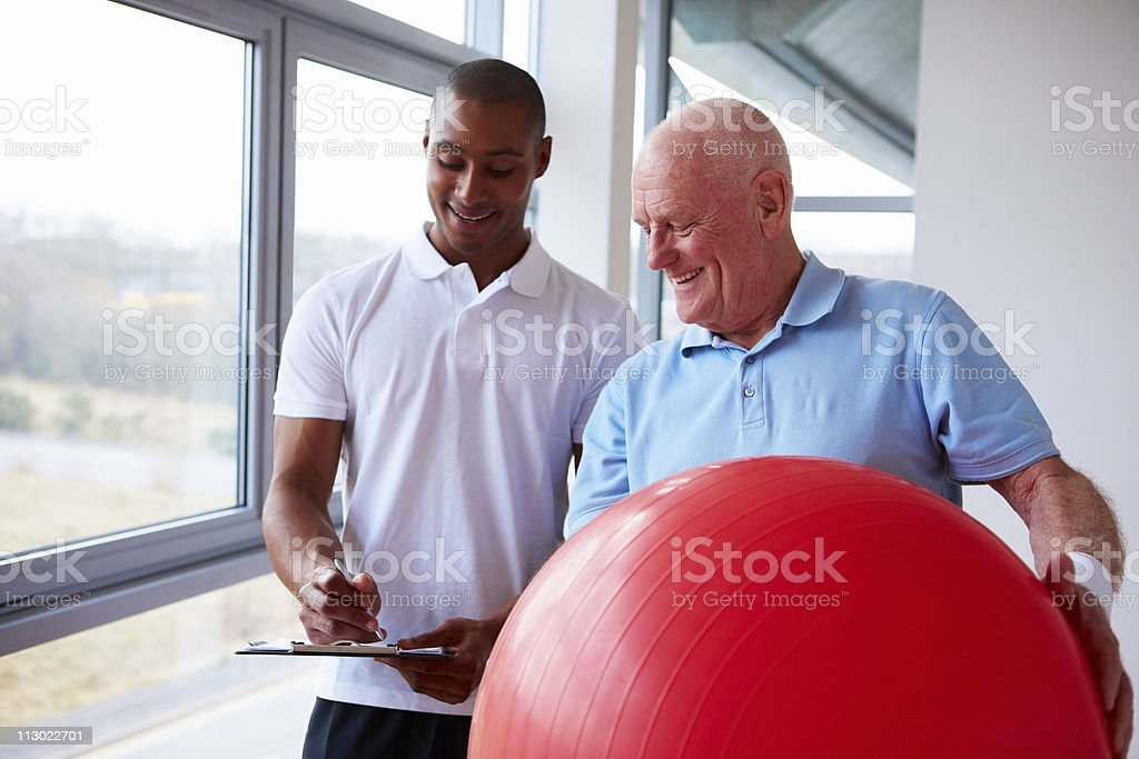 Senior Man Working with a Personal Trainer royalty-free stock photo