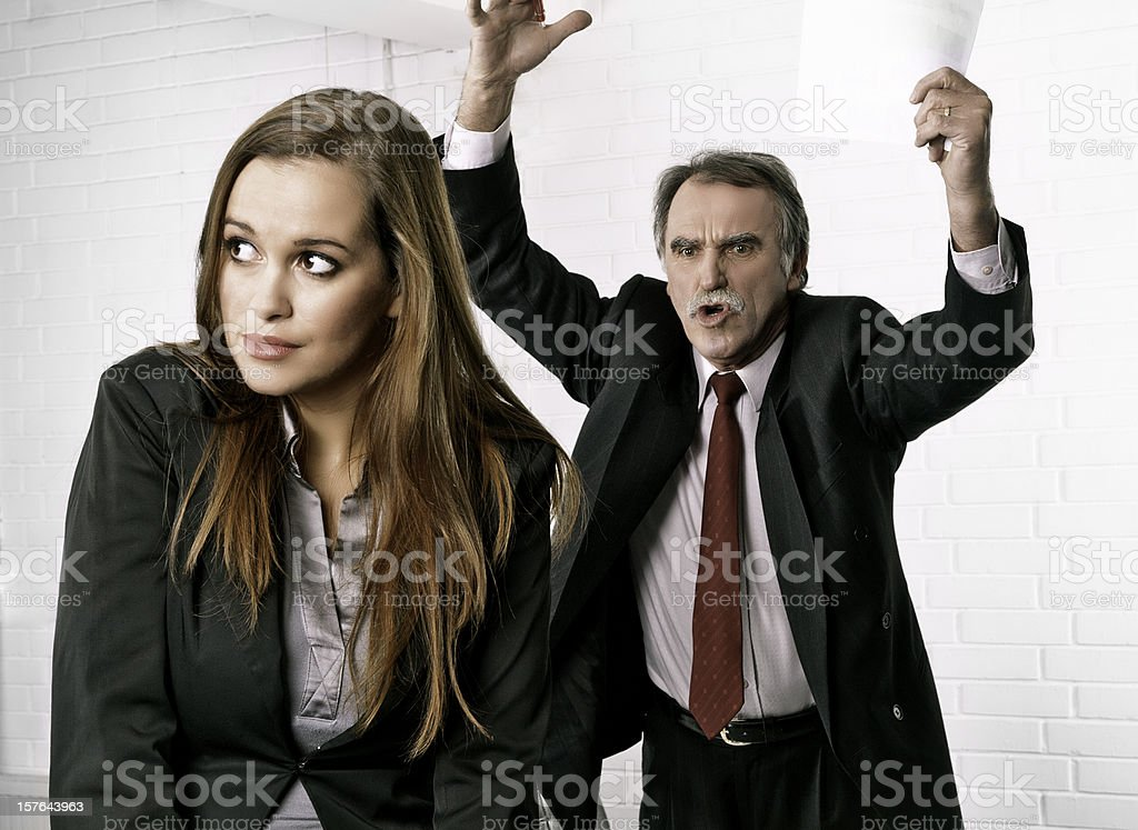 Senior manager angry at his secretary stock photo