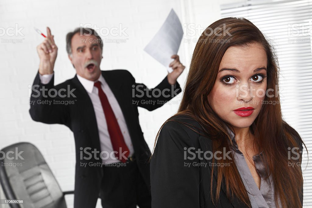 Senior manager angry at secretary stock photo