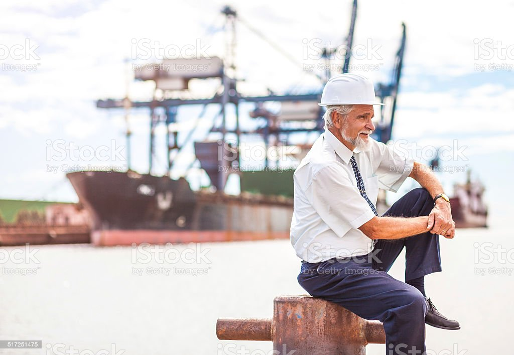 Senior Manager at the commercial dock stock photo
