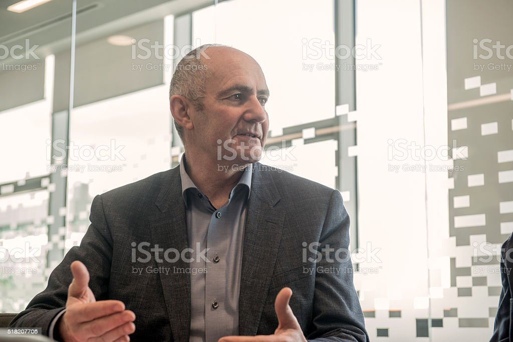 Senior manager in a meeting stock photo