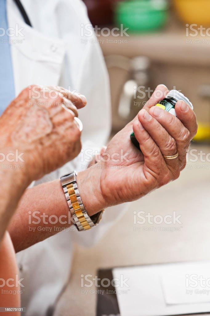 Senior man's hands holding prescription bottle stock photo