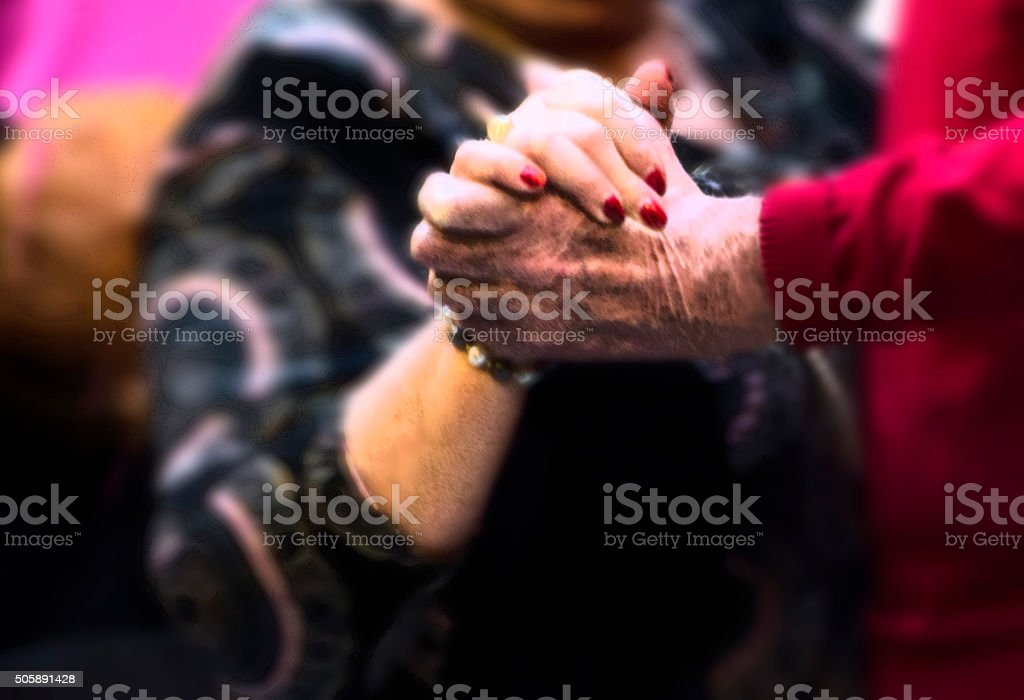 Senior married couple dancing and holding hands stock photo
