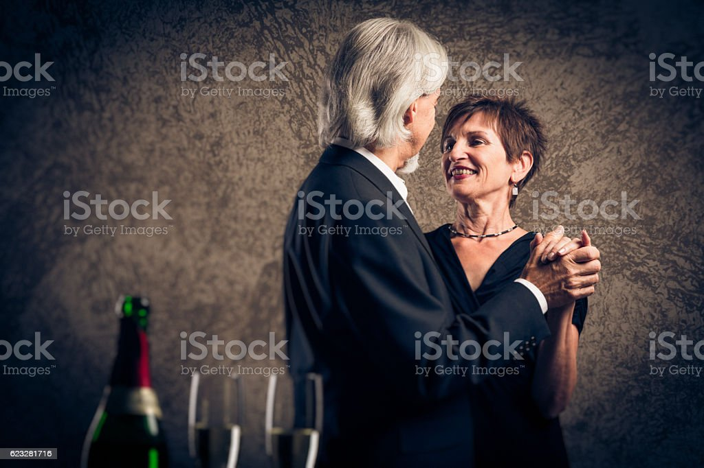 Senior married couple dancing stock photo