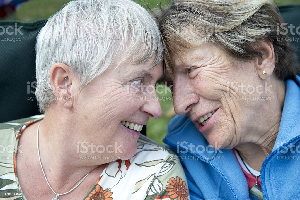 Senior Married Female Couple Laughing Together in Love stock photo