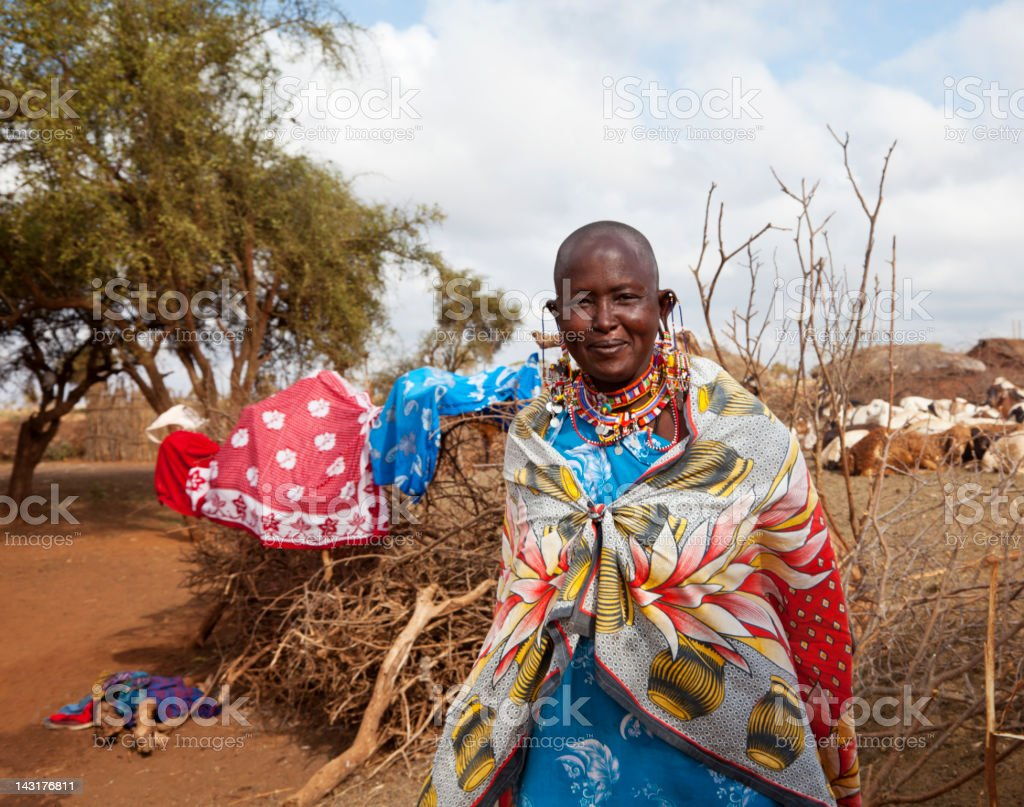 Senior masai woman in front of her village. royalty-free stock photo