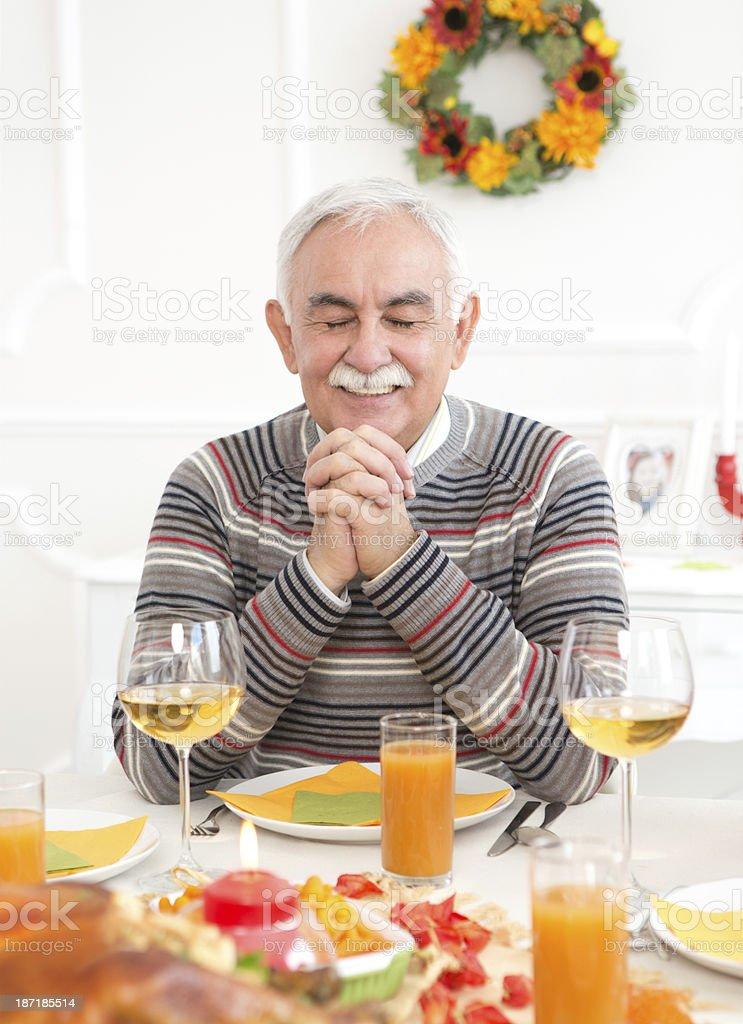 Senior men at thanksgiving dinner. royalty-free stock photo