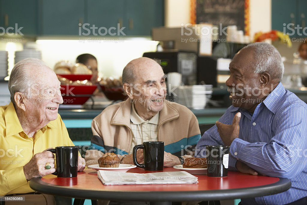 Senior men drinking tea together stock photo