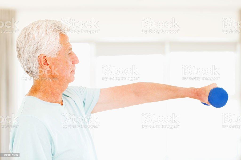 Senior Men Holding Dumbbell royalty-free stock photo