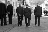 Senior Men in Suits Walking in Sicily, Italy
