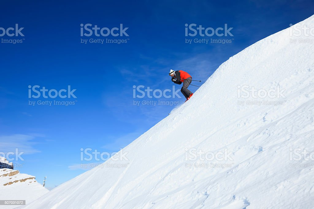 Senior men snow skier skiing off piste  sunny ski resorts stock photo