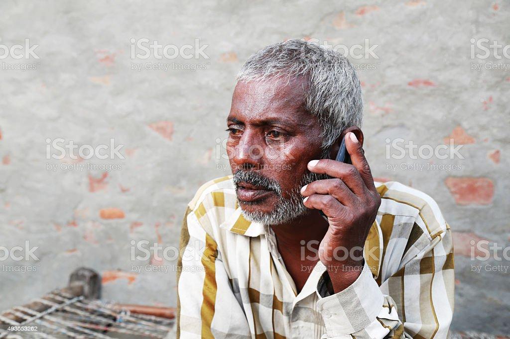 Senior Men Talking on Smartphone stock photo