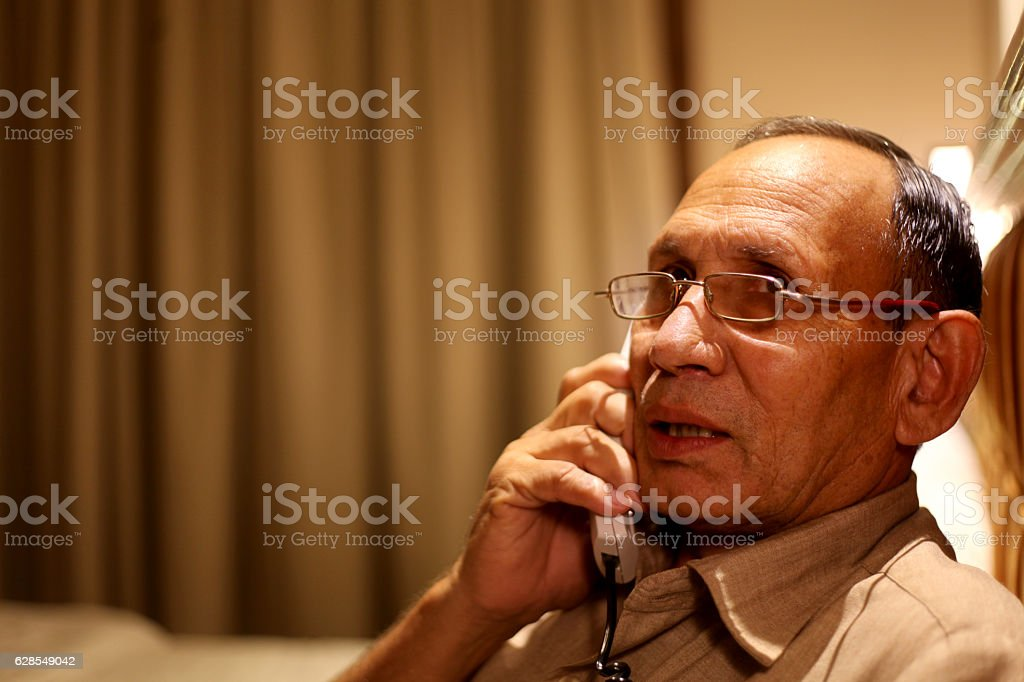 Senior men talking on telephone stock photo