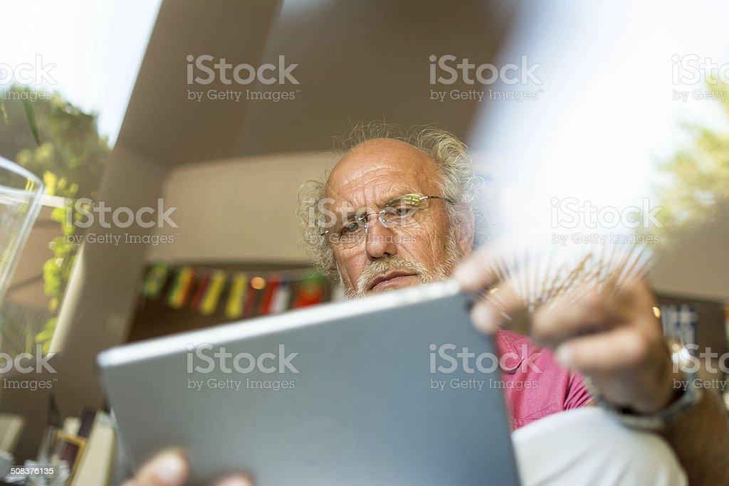 Senior men using digital tablet stock photo