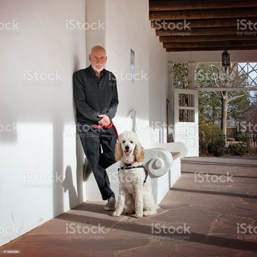 Senior Men with His Service Dog and a Best Friend stock photo