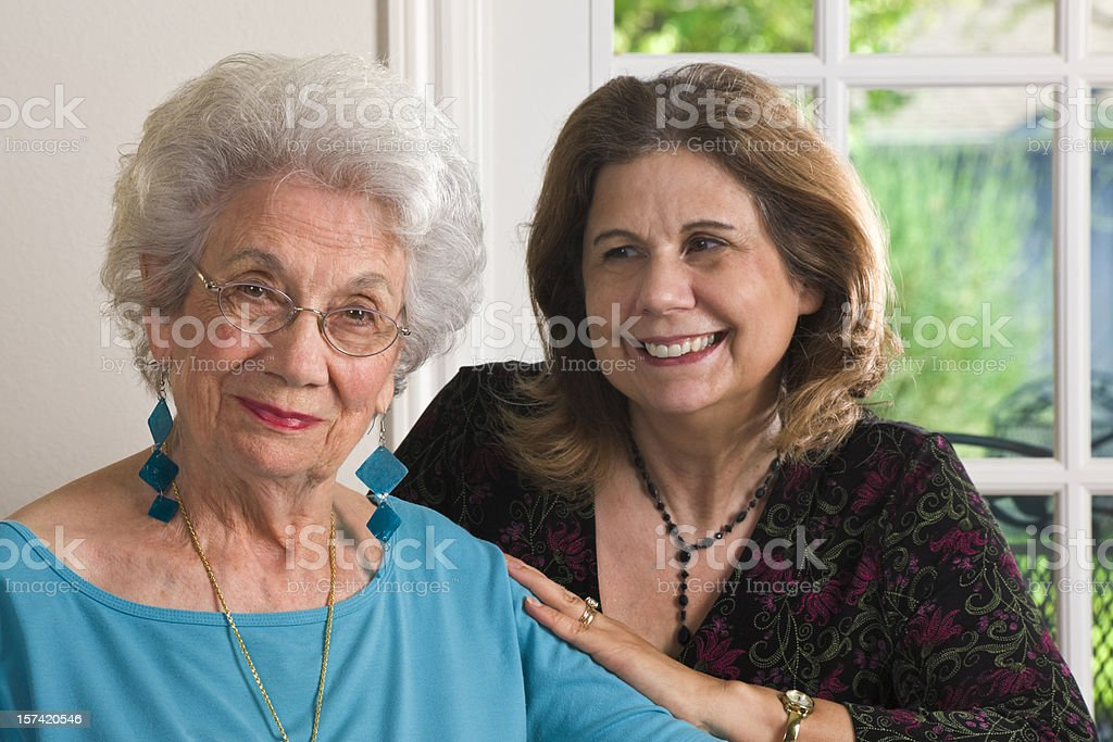 senior mother and mature daughter stock photo