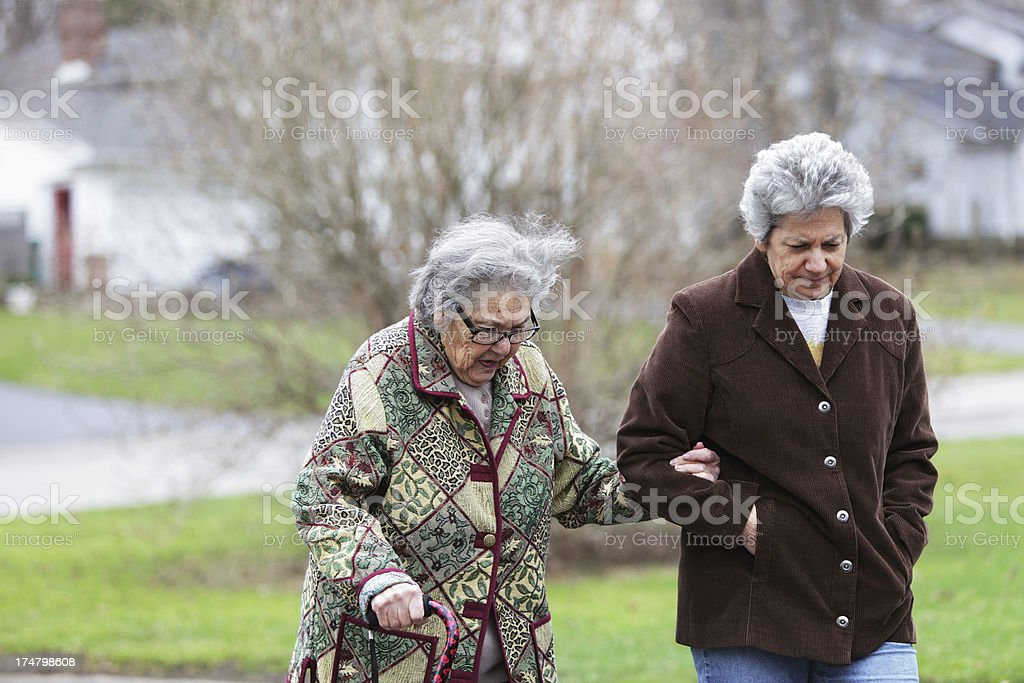 Senior Mother and Mature Daughter Walking royalty-free stock photo