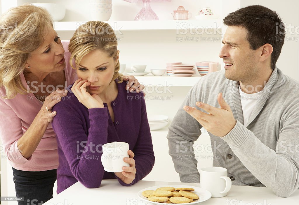Senior Mother Interfering With Couple Having Argument At Home stock photo