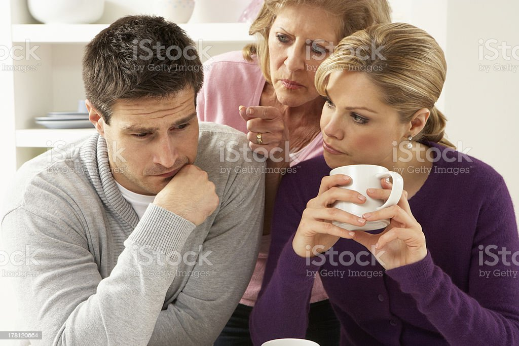 Senior mother talking with couple having an argument at home stock photo