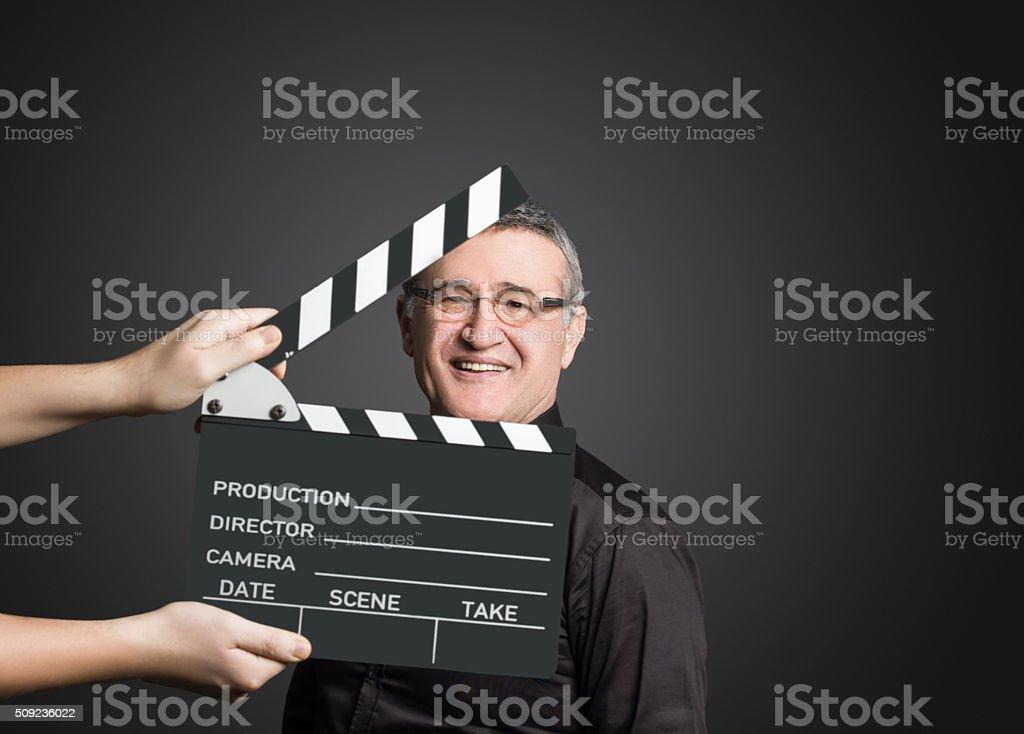 Senior movie director looking at camera stock photo