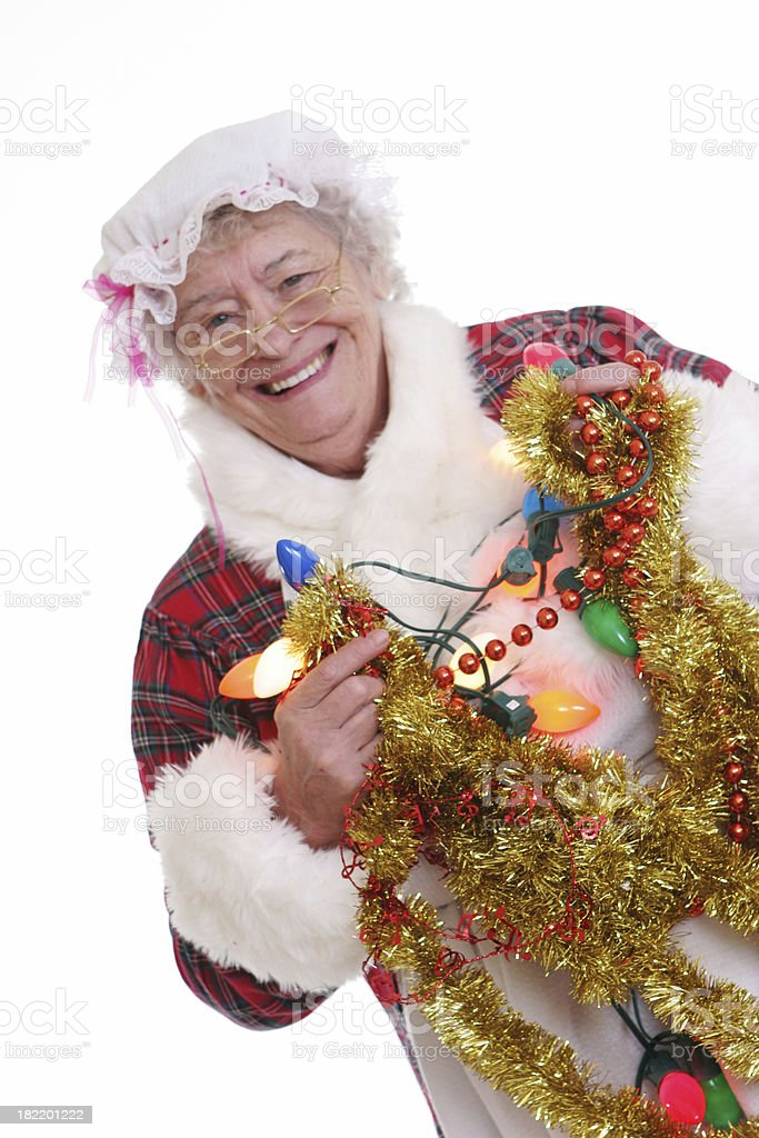 Senior Mrs Claus with garland and lights royalty-free stock photo