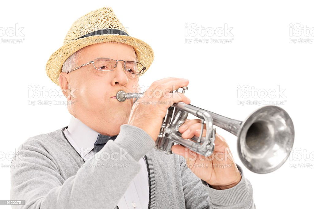 Senior musician playing a trumpet royalty-free stock photo