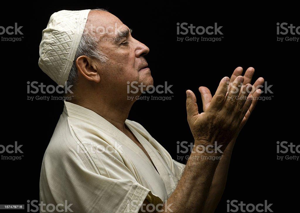 Senior muslim man praying stock photo
