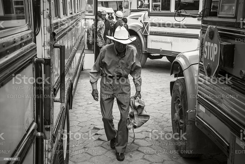 Senior man and buses in Nicaragua stock photo