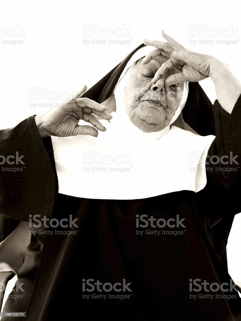 Senior Nun Pinching Nose Close, Sepia Toned stock photo