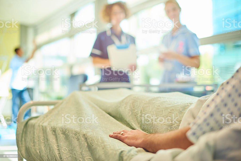 senior nurse chatting to student nurse and patient stock photo