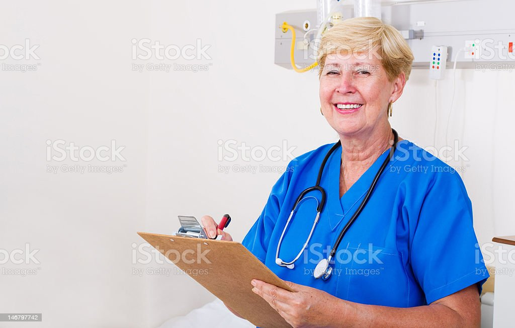 senior nurse in hospital ward stock photo