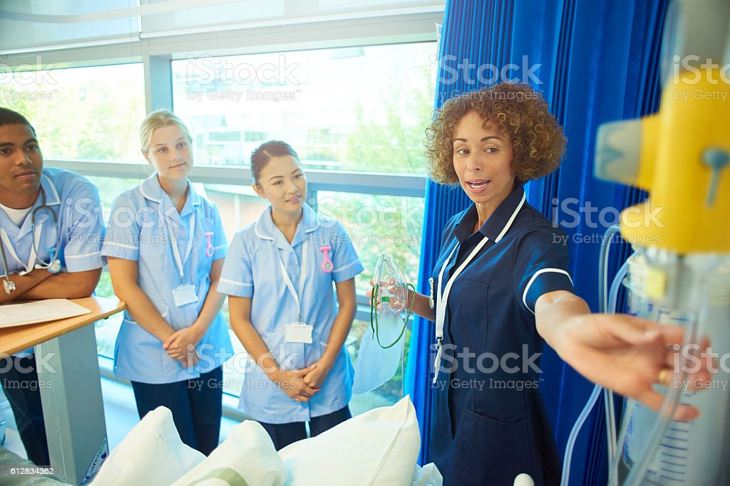 senior nurse team training young nurses stock photo