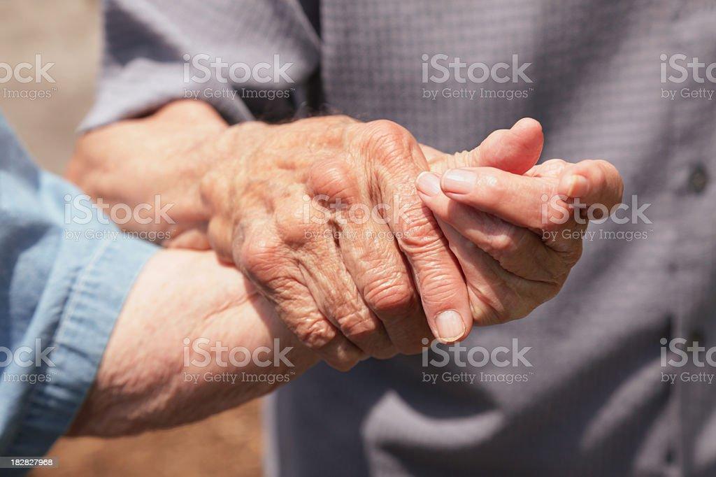 Senior Octogenarian Couple Holding Hands royalty-free stock photo