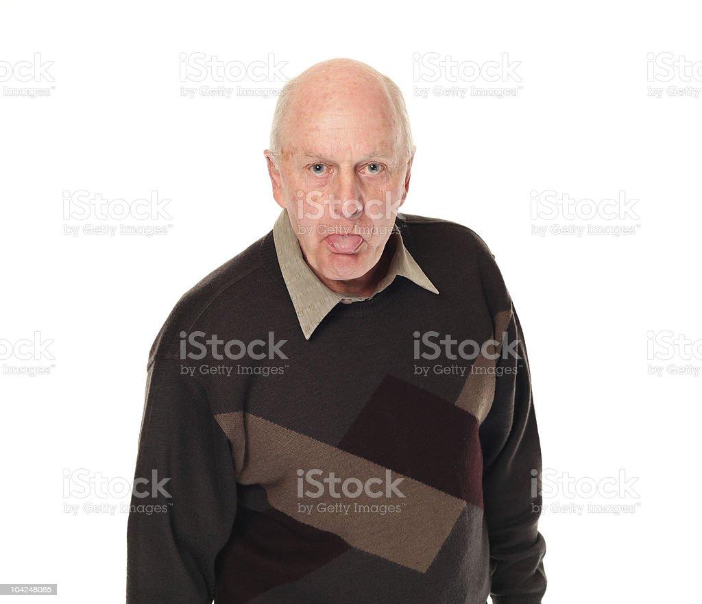 Senior older man sticking out tongue stock photo